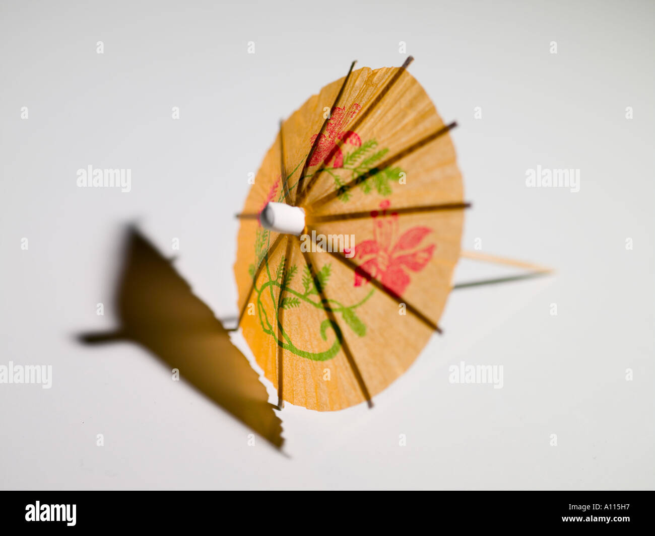 umbrella, paper, toothpicks, small, wooden, to drink, landscaping, close up, white background, yellow, green, red, drawings - Stock Image