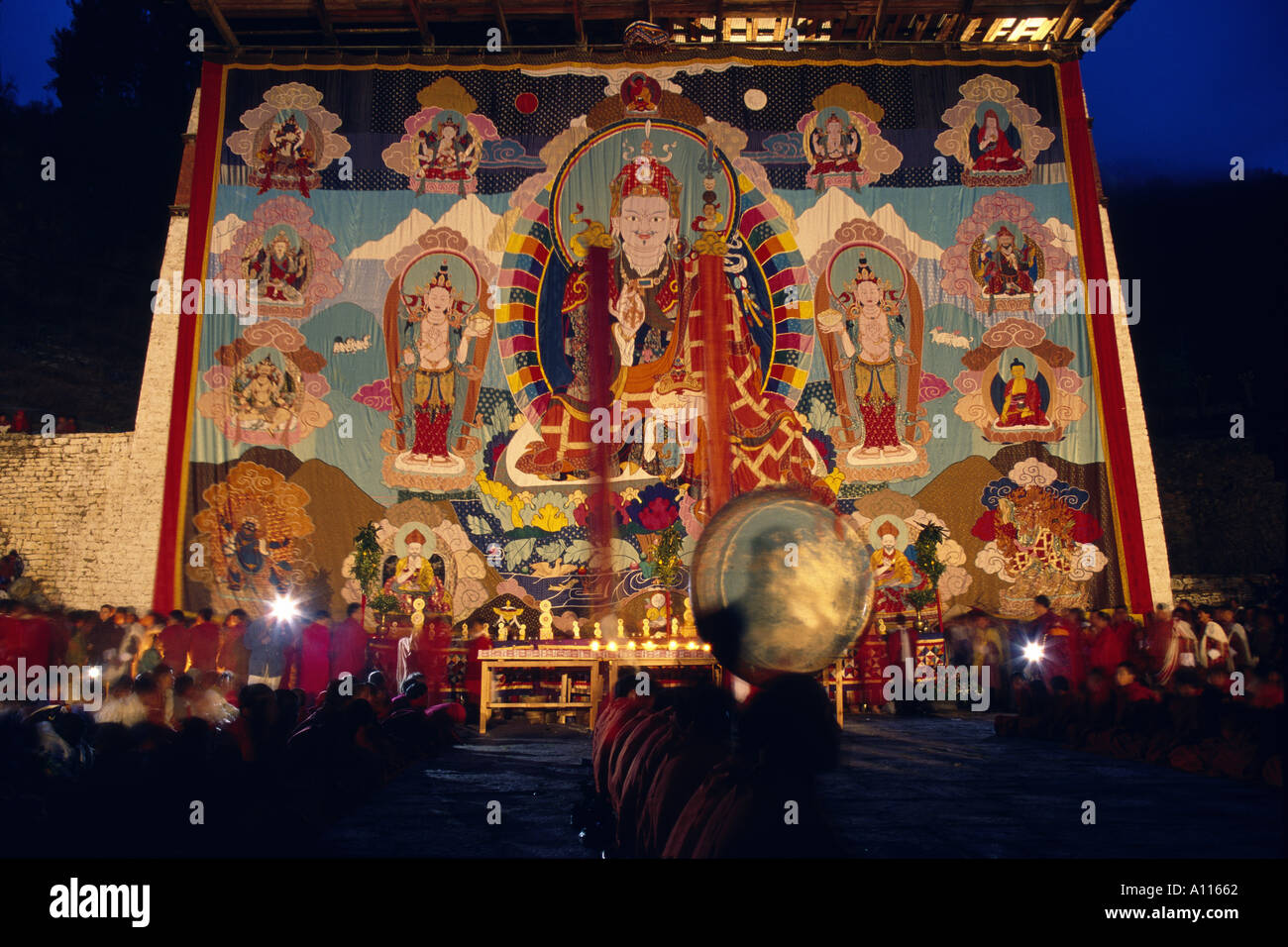 Buddhist monks at Paro Dzong with painted Thanka Paro Bhutan - Stock Image