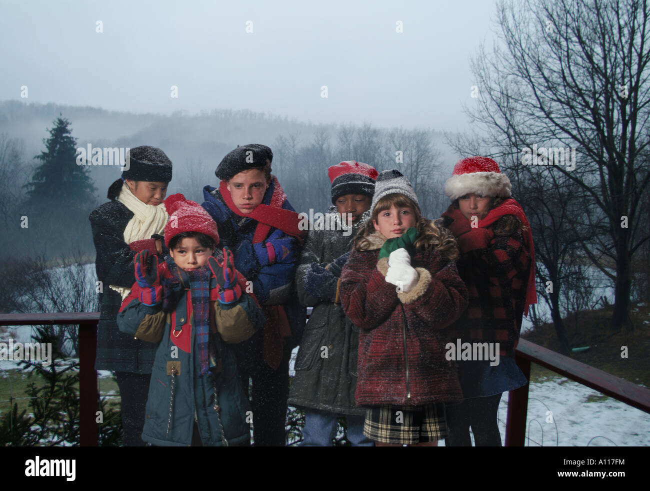 children huddled in extremely cold weather - Stock Image