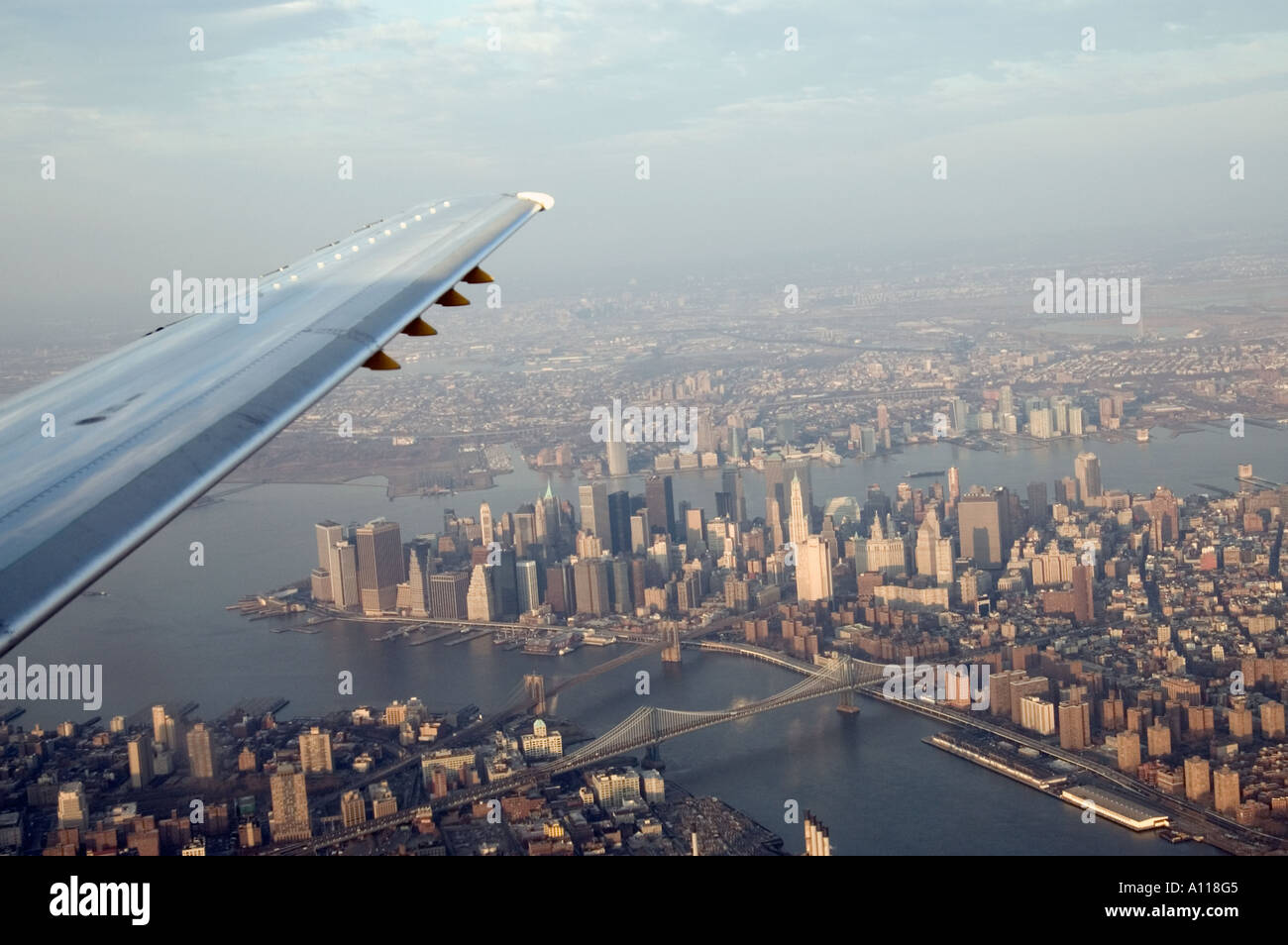 Aerial view of lower Manhattan New York City USA with aircraft wing ...