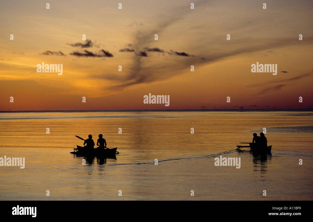 Outrigger canoes at sunset Tarawa Kiribati Central Pacific - Stock Image
