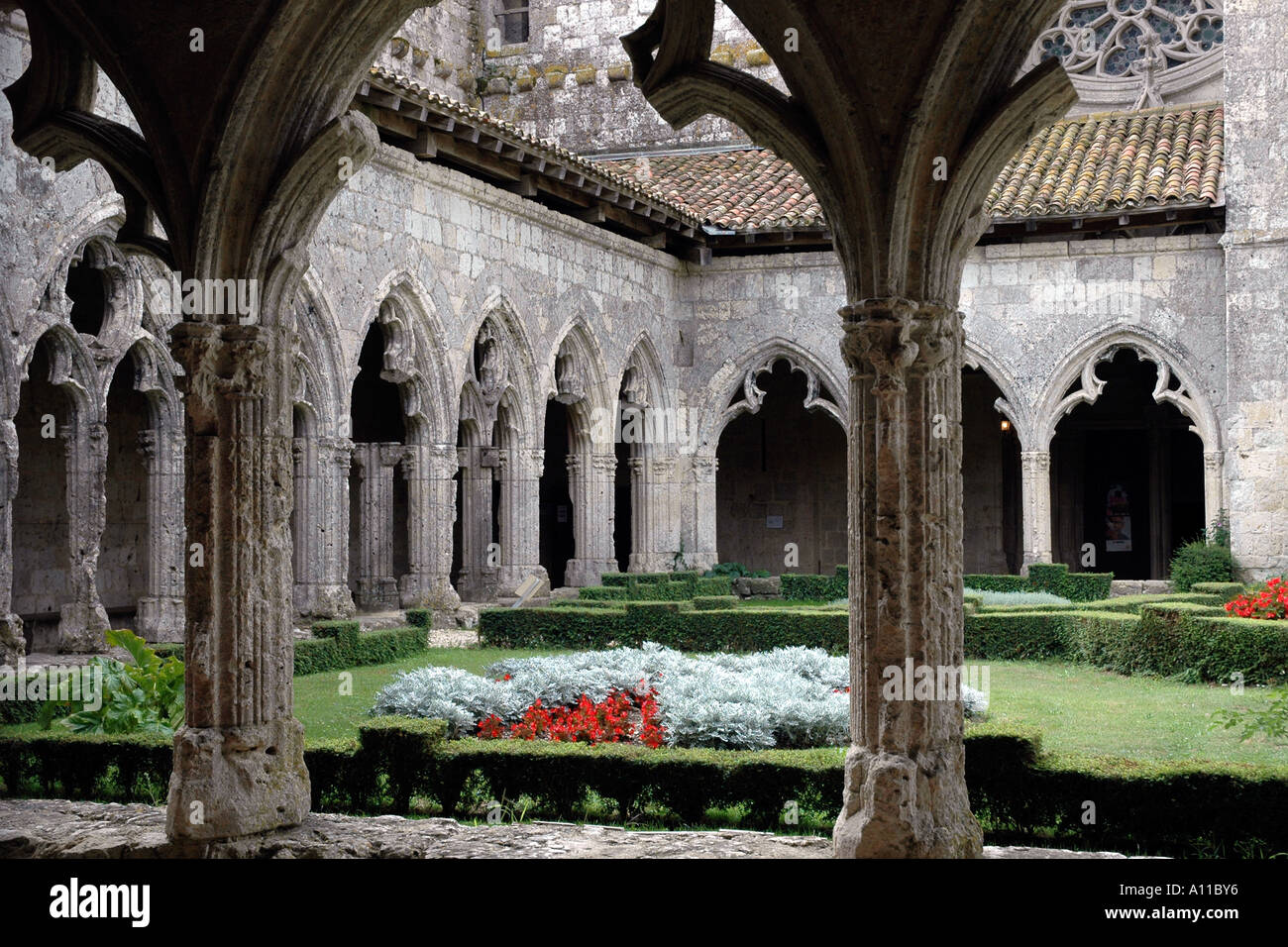 The Gothic cloisters of the 14th century collegiate church of La Romieu, a pretty village in southwest France - Stock Image