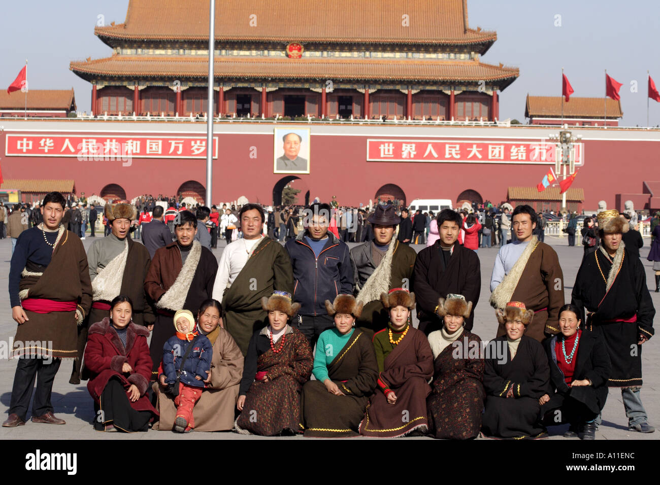 Tibetan tourists from Chamdo pose in front of  the Forbidden City's Gate of Heavenly Peace,  Beijing China - Stock Image