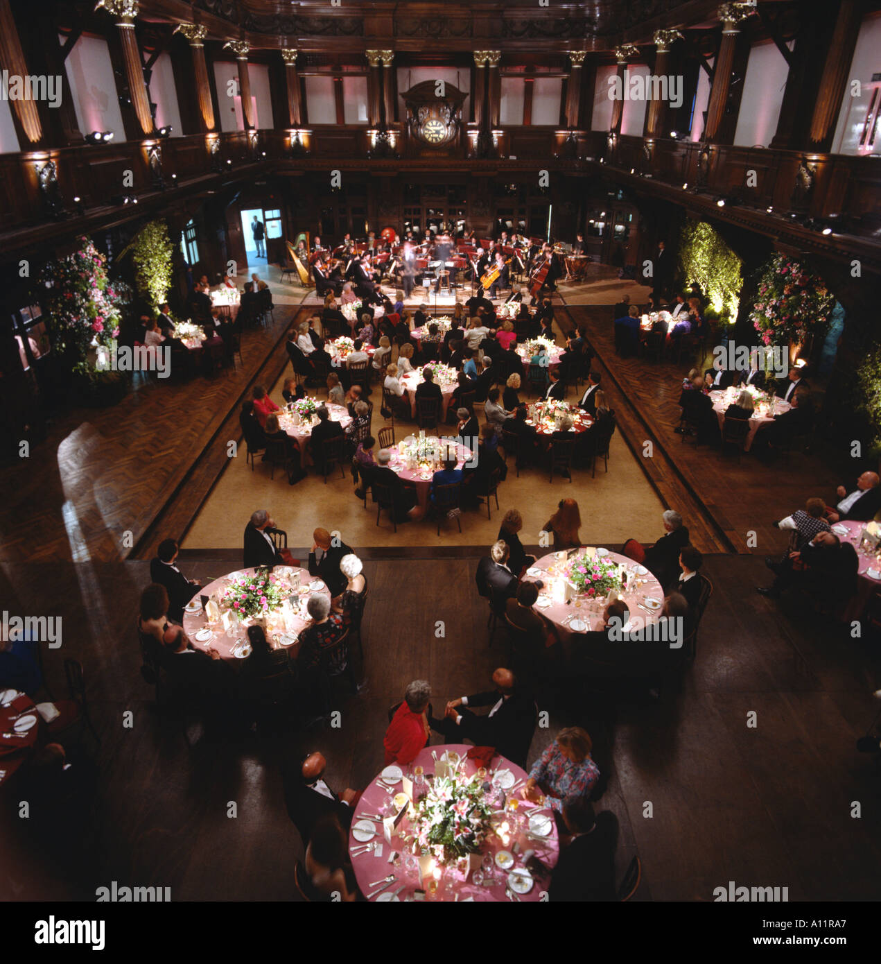 The Welsh National Opera Orchestra entertain guests at a Charity Dinner held at The Coal Exchange Cardiff Bay Wales Great Britai - Stock Image