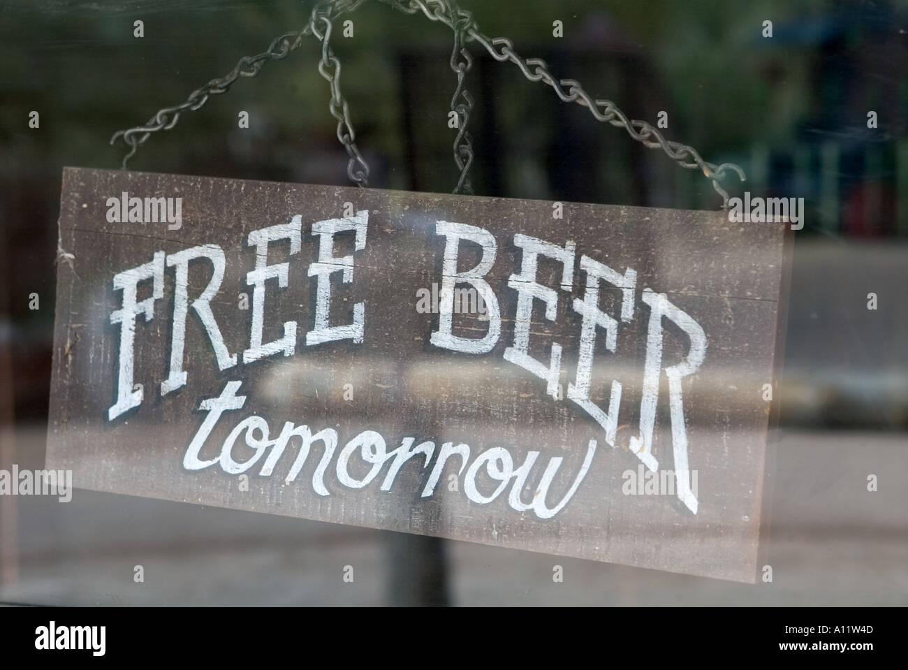 Free beer tomorrow sign on bar door Arizona USA - Stock Image