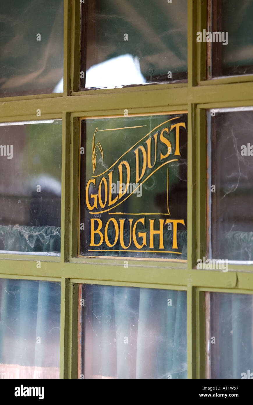 Gold dust bought old western sign in a shop window at Old Tucson Studios Stock Photo