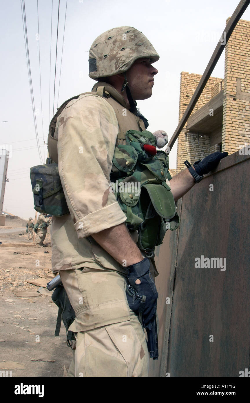 9 April 2003 Bagdad Iraq Marines of the 3rd Battalion 4th Marines search houses as they enter the center of bagdad Stock Photo