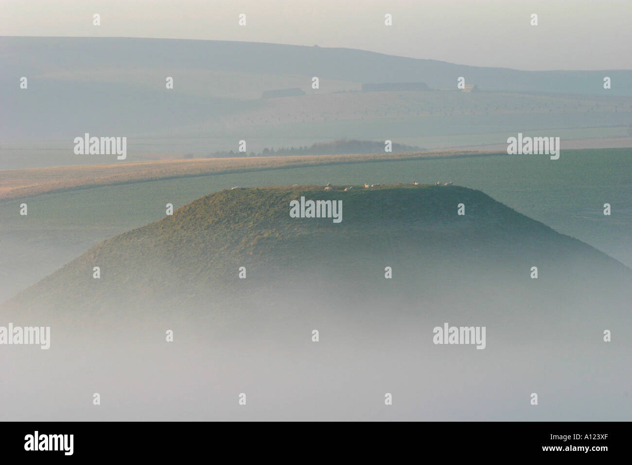 Silbury Hill mysterious Neolithic monument in Wiltshire shrouded in early morning mists - Stock Image