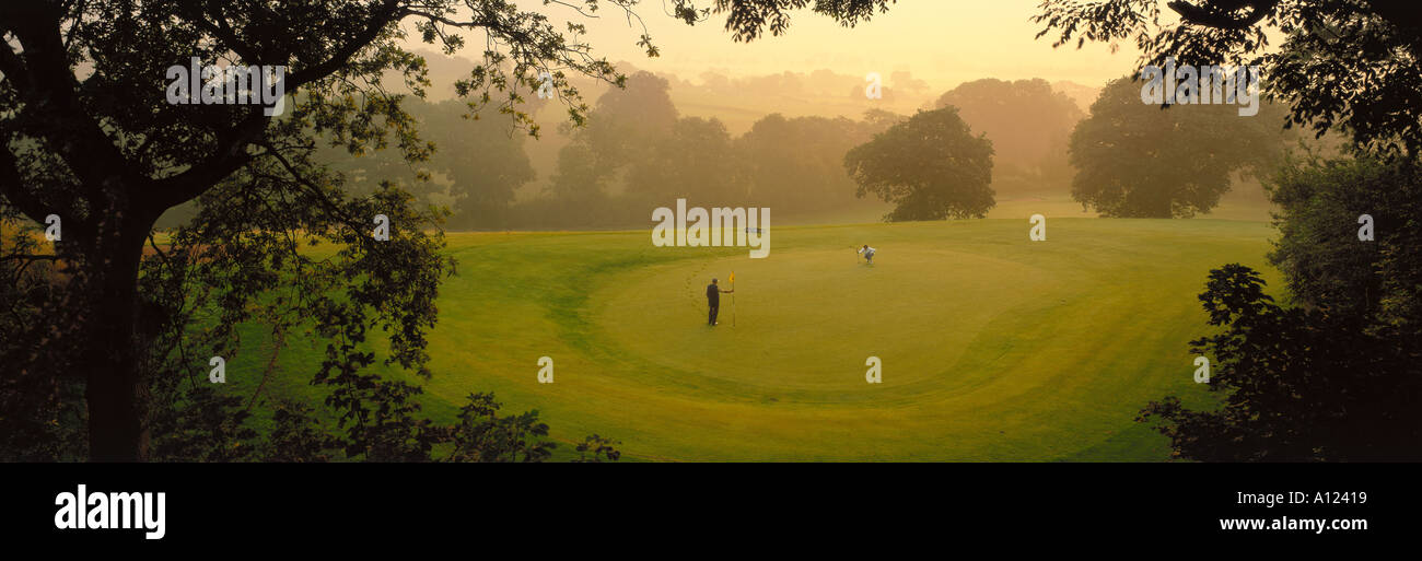 Golfing Couple Cheshire UK - Stock Image