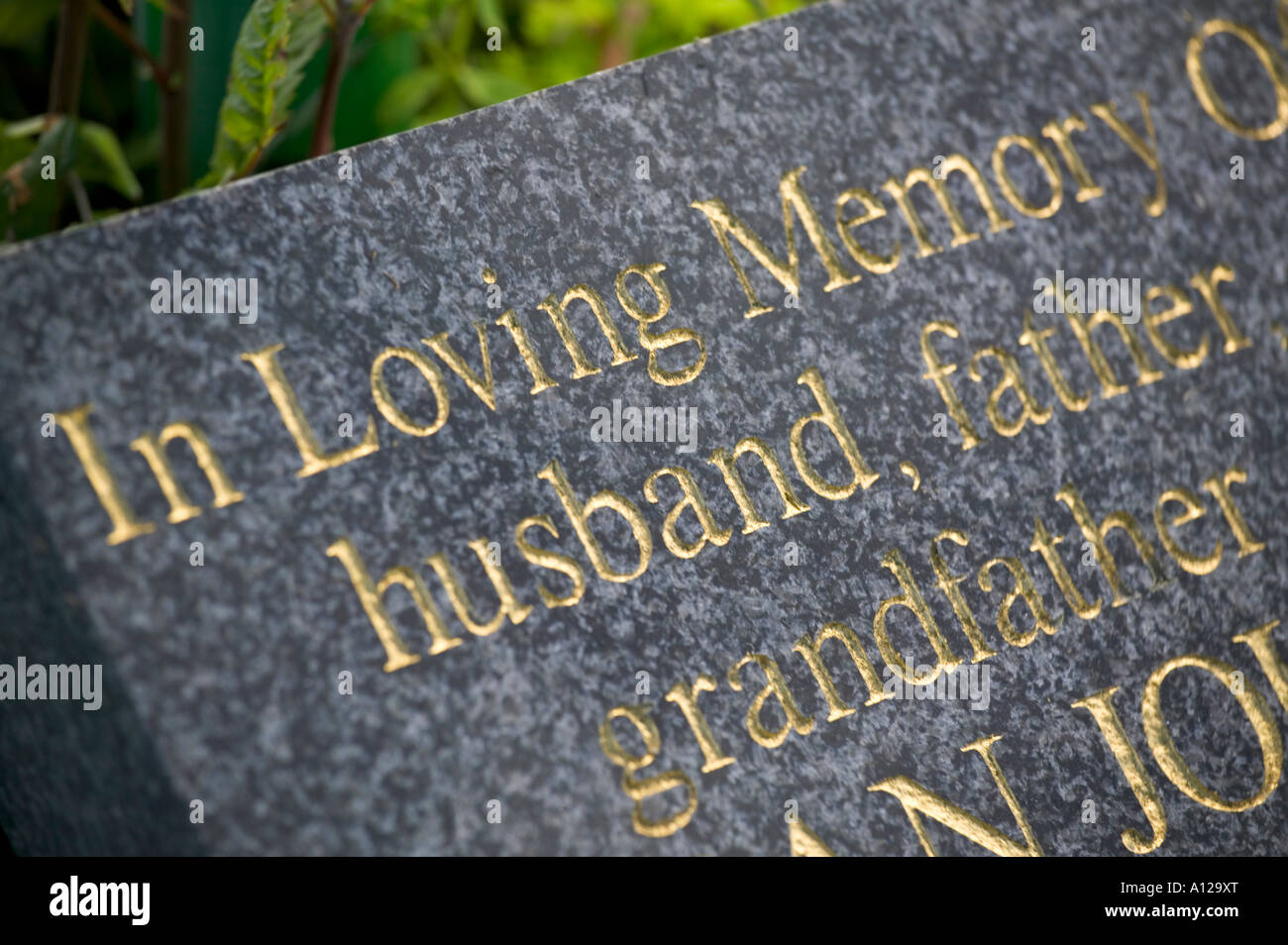 Headstone husband father grandfather - Stock Image
