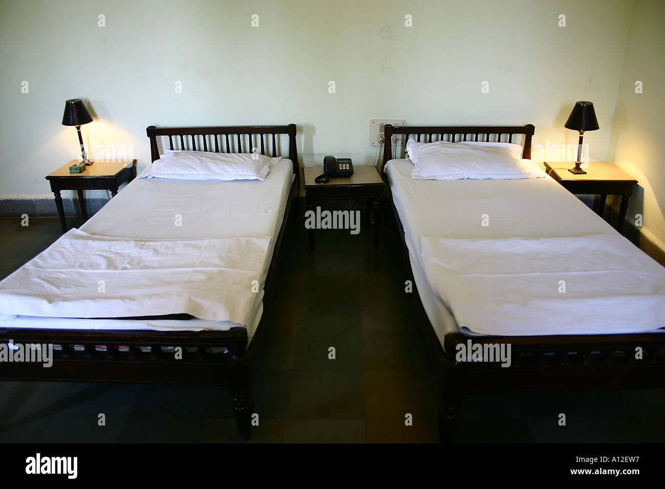 Empty Double Two Beds With White Sheets Pillows Side Tables Lit