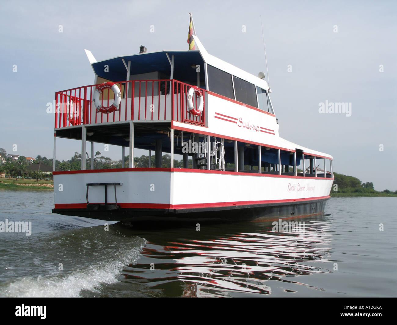 Tourist launch on Lake Victoria, Uganda - Stock Image