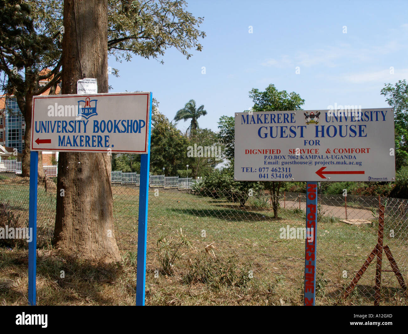 Signboards for the university bookshop and the guest house on Makerere University Campus - Stock Image