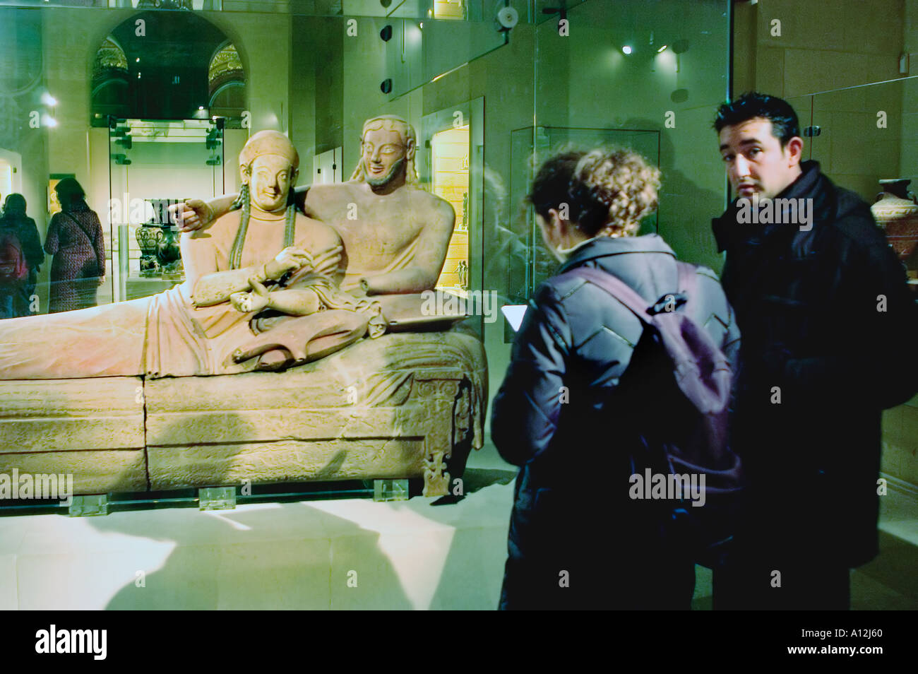 "Paris France Couple Visiting in ""Louvre Museum""""The Etruscan Sarcophagus of a Married Couple"" Sculpture Stock Photo"