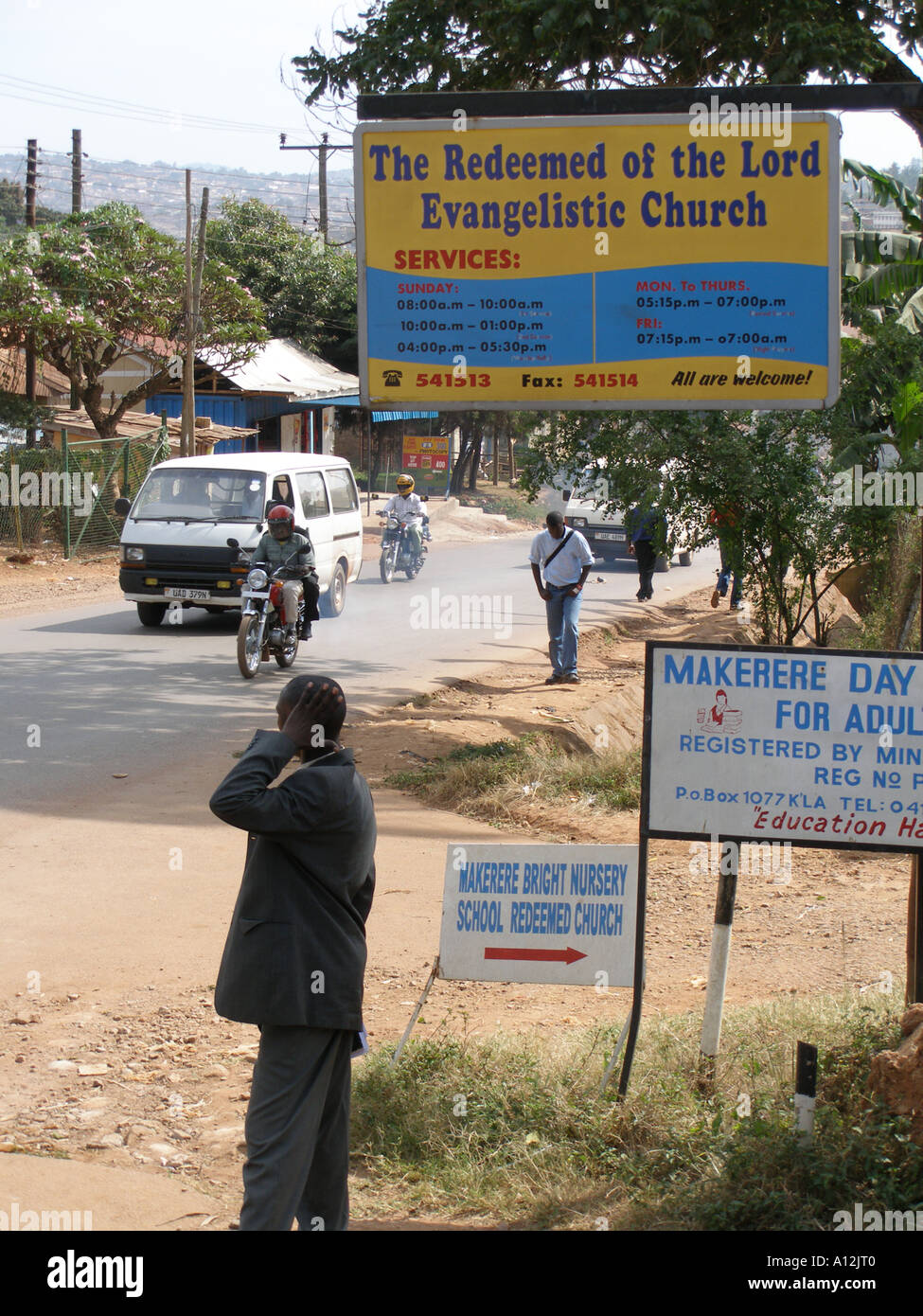 Sign for The Redeemed of the Lord Evangelistic Church among others on a Kampala road, Uganda - Stock Image