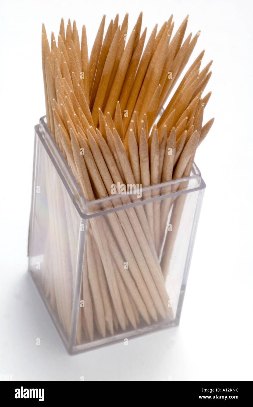 Box of wooden cocktail sticks or toothpicks Isolated white background - Stock Image