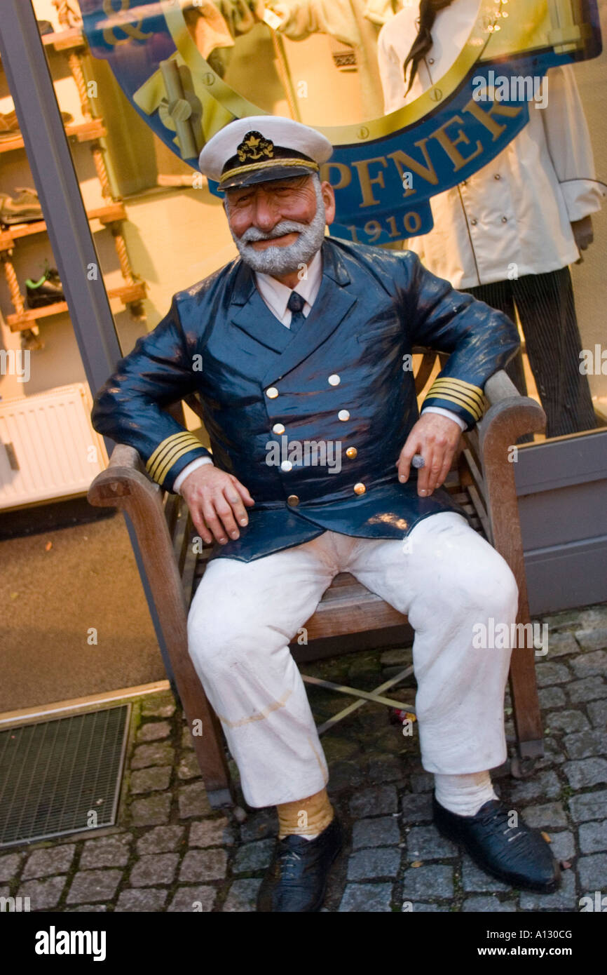 Wooden sculpture of sea captain at Weinachtsmarkt in Lubeck.Christmas market Lübeck Schleswig Holstein Germany - Stock Image