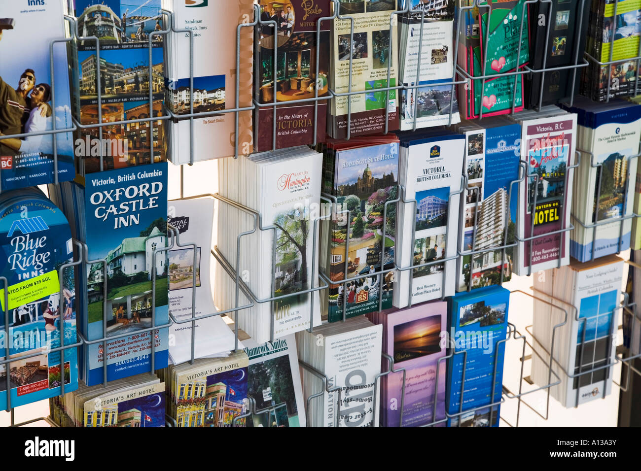 Canadian tourist brochures in an information office Victoria Canada - Stock Image