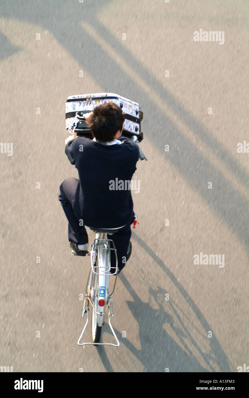 Schoolboy on a bicycle Kyoto Japan - Stock Image