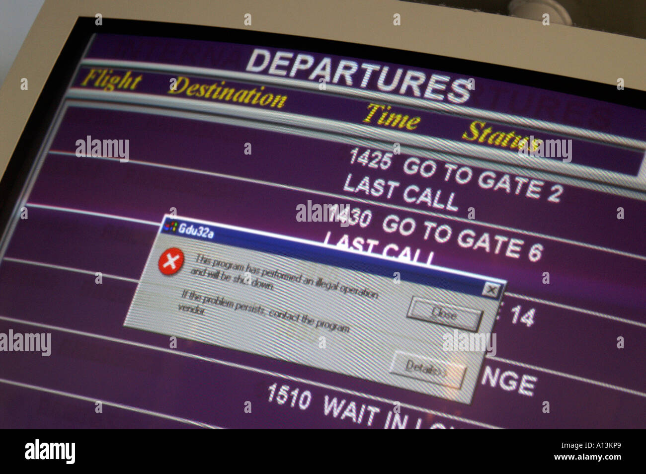 Old Windows error message tells Newcastle UK air travellers in 2006 the announcement system has crashed - Stock Image