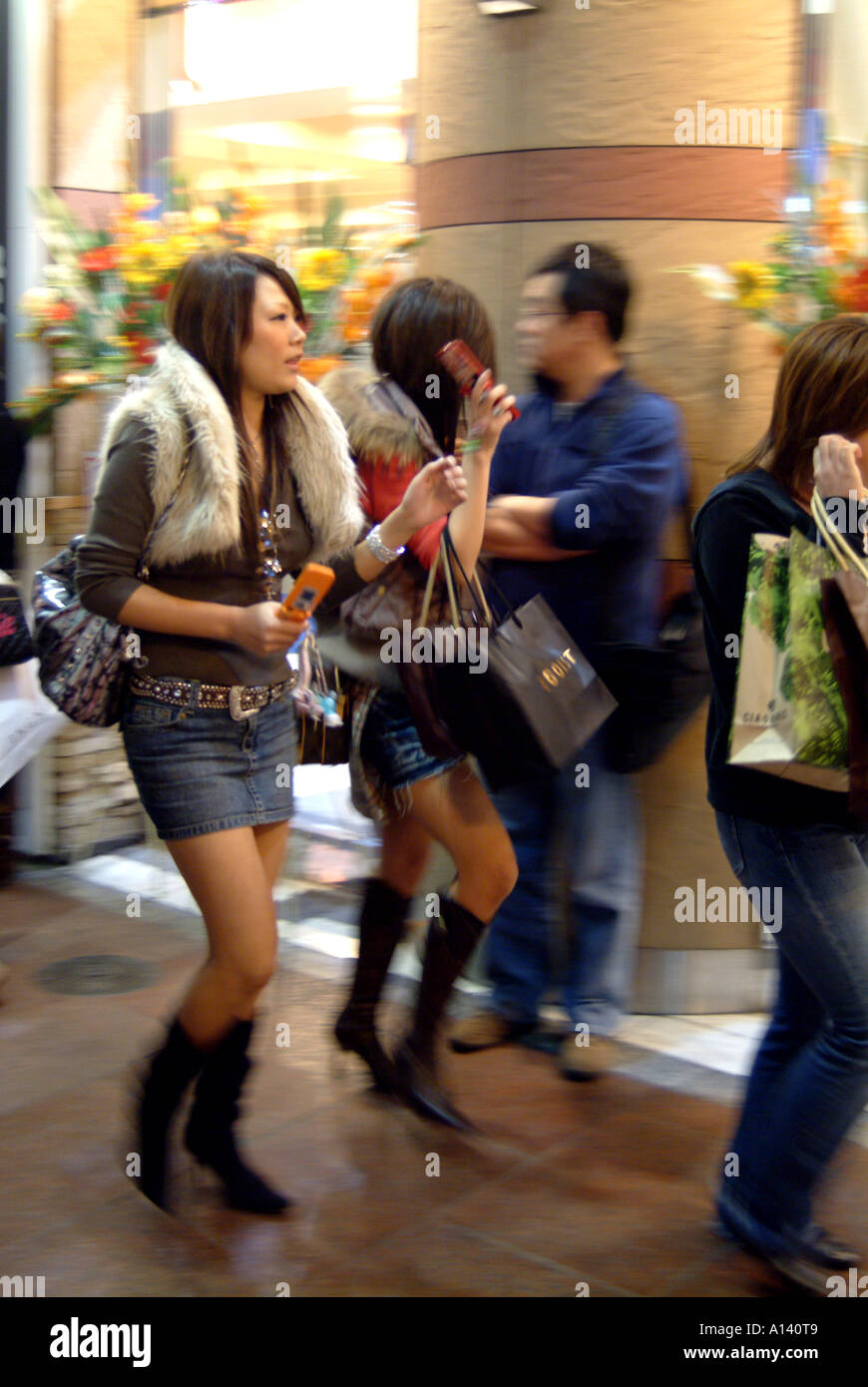 Fashionable girls with mobile phones Kyoto Japan - Stock Image