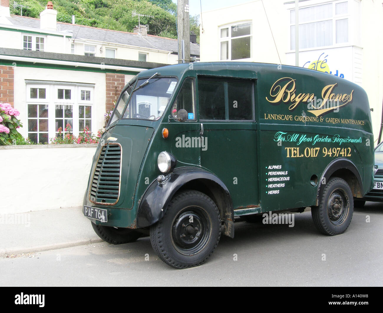 three quarter view of fifties Morris J type Van by roadside - Stock Image