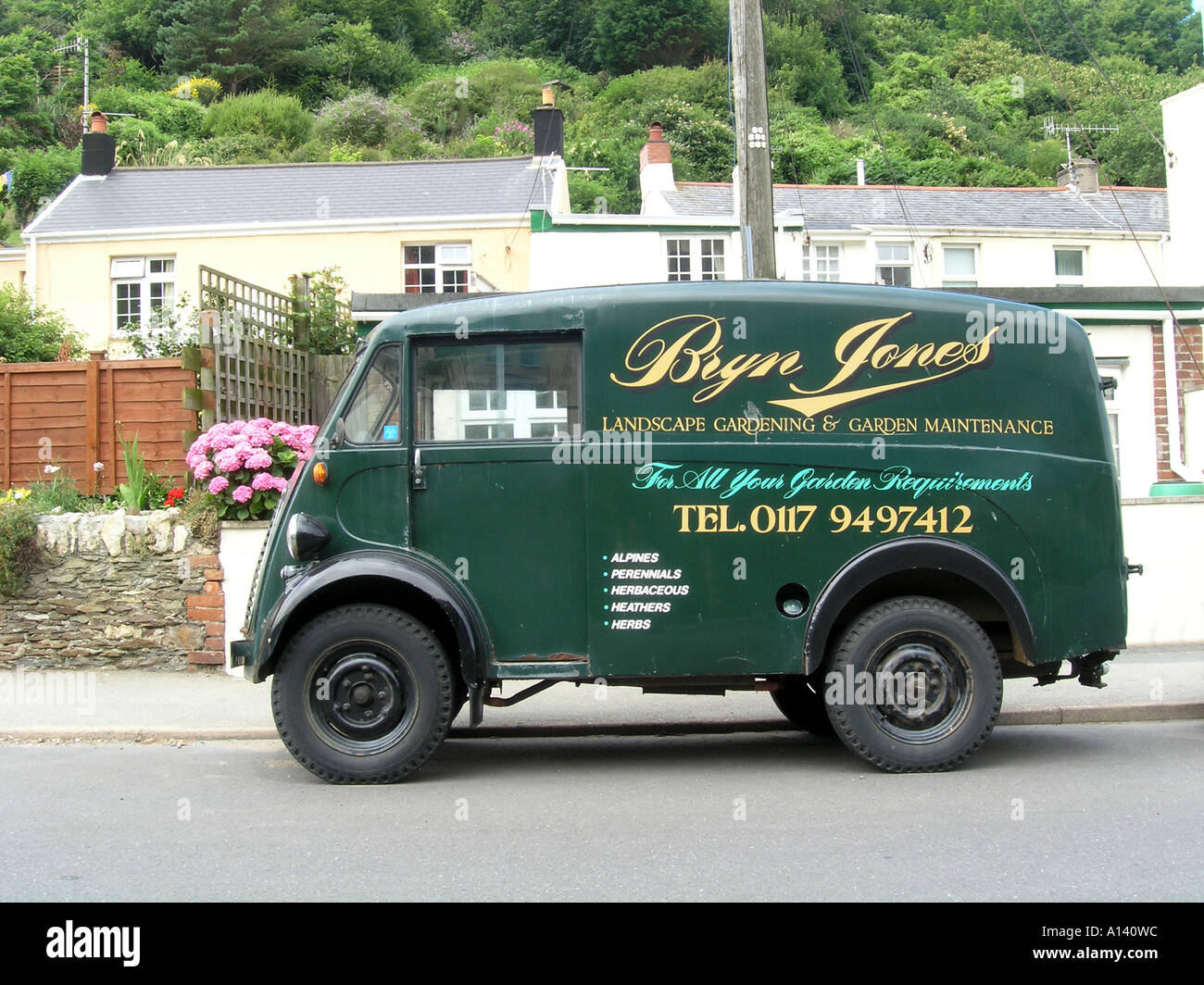 side view of fifties Morris J type Van by roadside - Stock Image