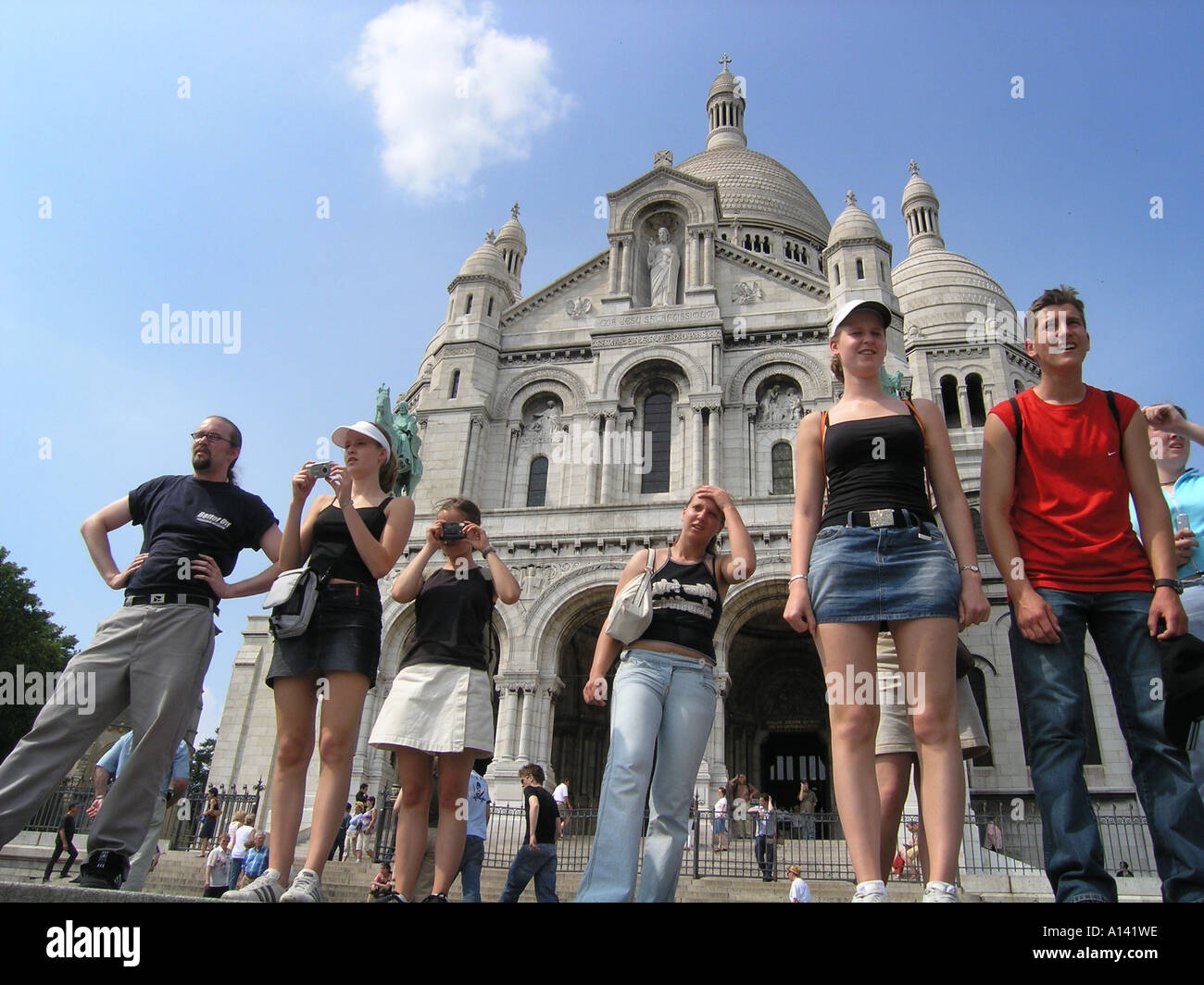 snapshot of school group in front of Sacre Coeur Paris France - Stock Image