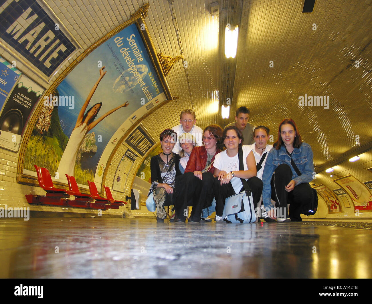 posed snapshot of teenagers in Parisian  underground station Pont Marie - Stock Image
