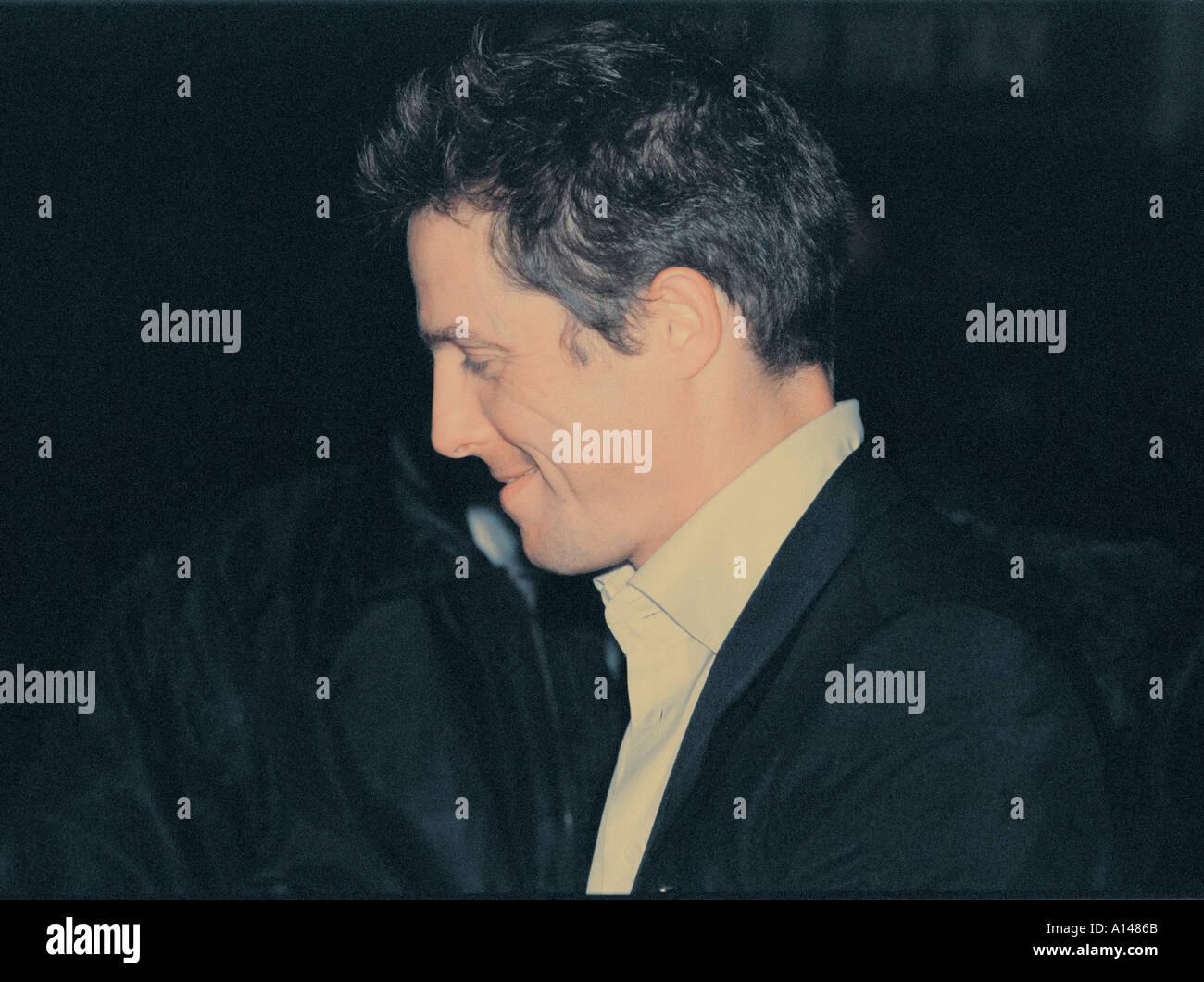 Hugh Grant actor leaving Atlantic club Soho London - Stock Image
