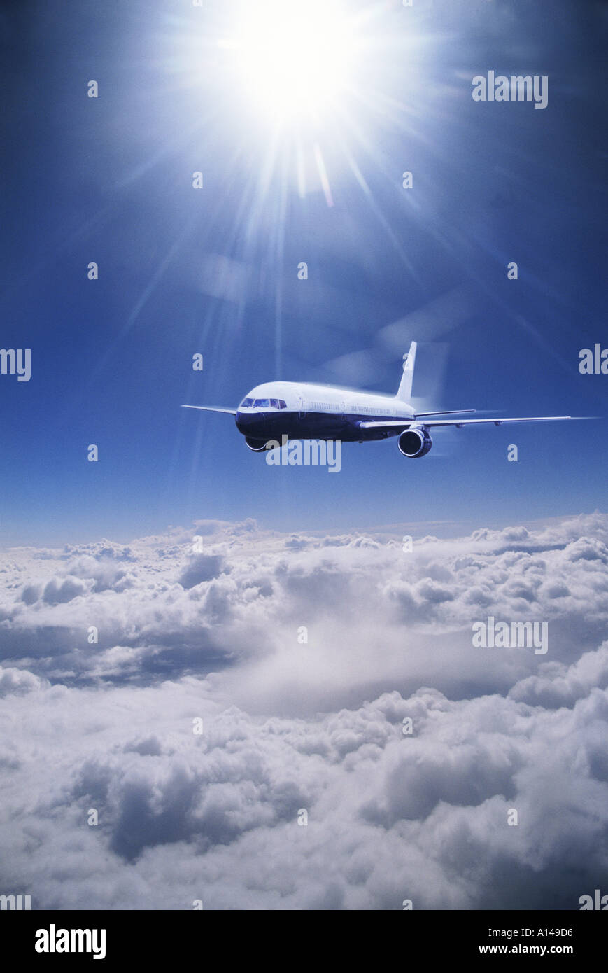 Aeroplane flying above the clouds - Stock Image