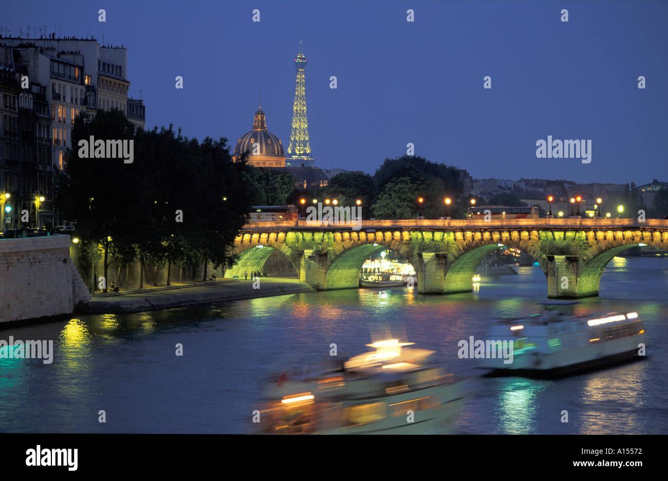Eiffel Tower River Seine Pont Neuf at Night Paris France - Stock Image