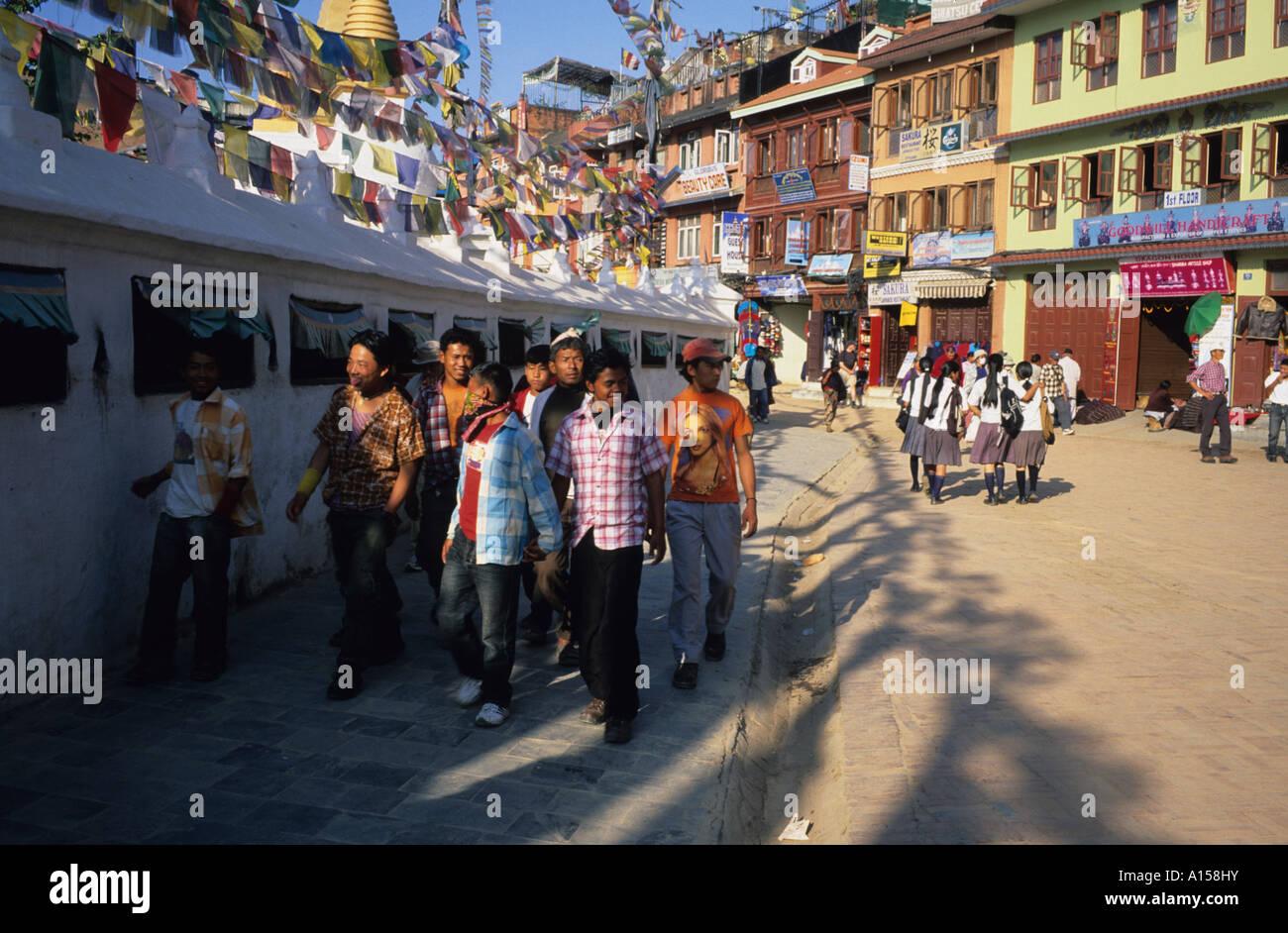 Bouddha Nath Stupa young men and women, Little Tibet, Kathmandu, Nepal Asia - Stock Image