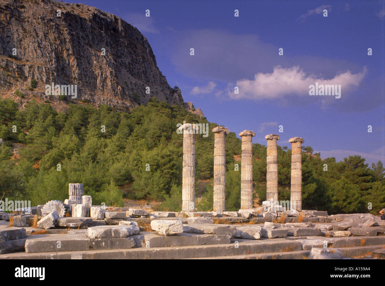Columns and ruins of the Ionian Temple to Athena and the Greek theatre at the archaeological site of Priene in Turkey Stock Photo
