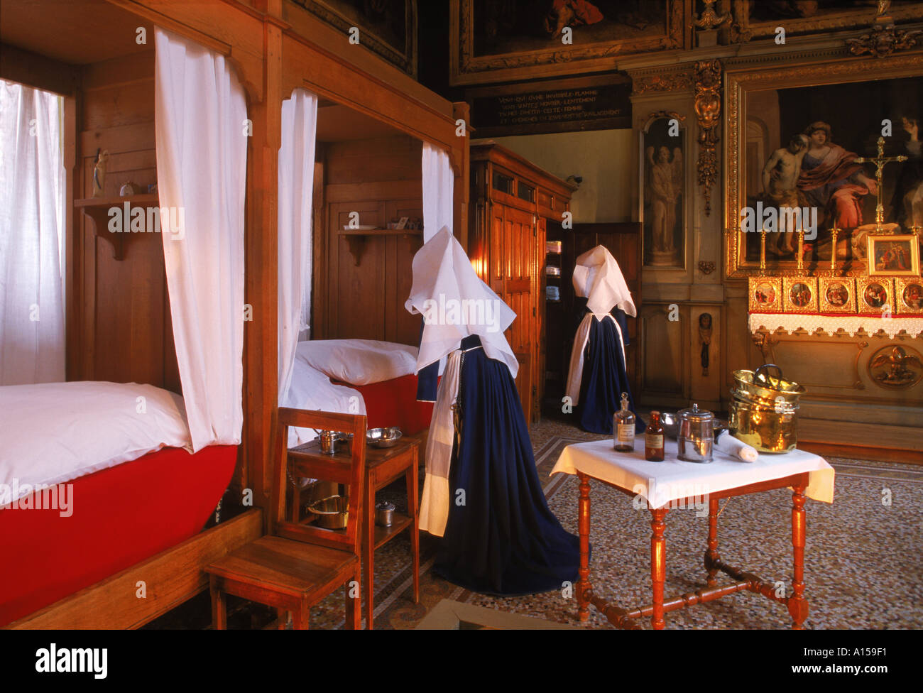 Interior of a tableau showing work of the nursing sisters in the Hotel Dieu in Beaune Burgundy France A Woolfitt - Stock Image