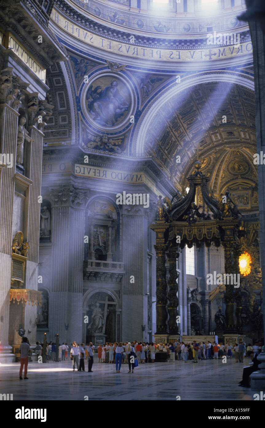 Tourists in the interior of St Peters Basilica in Rome Lazio Italy A Woolfitt - Stock Image
