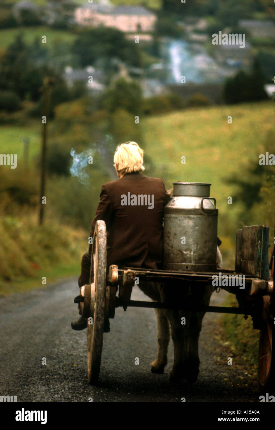 Figure riding cart with milk churn Arigna Shannon River Co Leitrim Ireland A Woolfitt Stock Photo