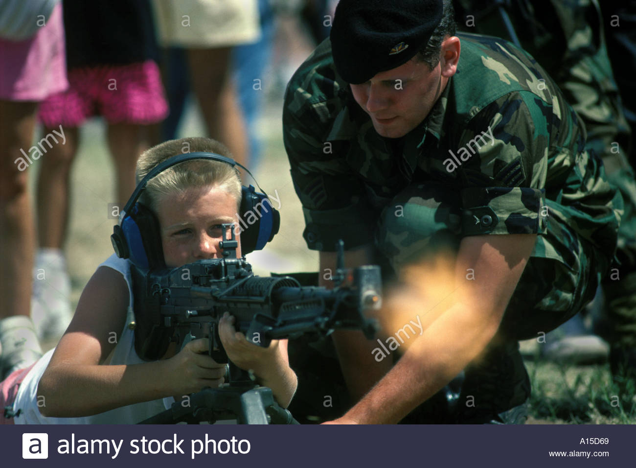 Boy fires demo M60 machinegun at Airforce Base open house - Stock Image