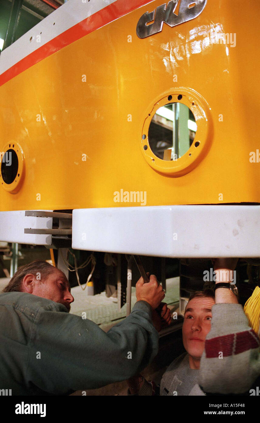 Workers prepare a tram at the CKD tram and train factory in Prague Monday October 25 1999 in the Czech Republic. Stock Photo