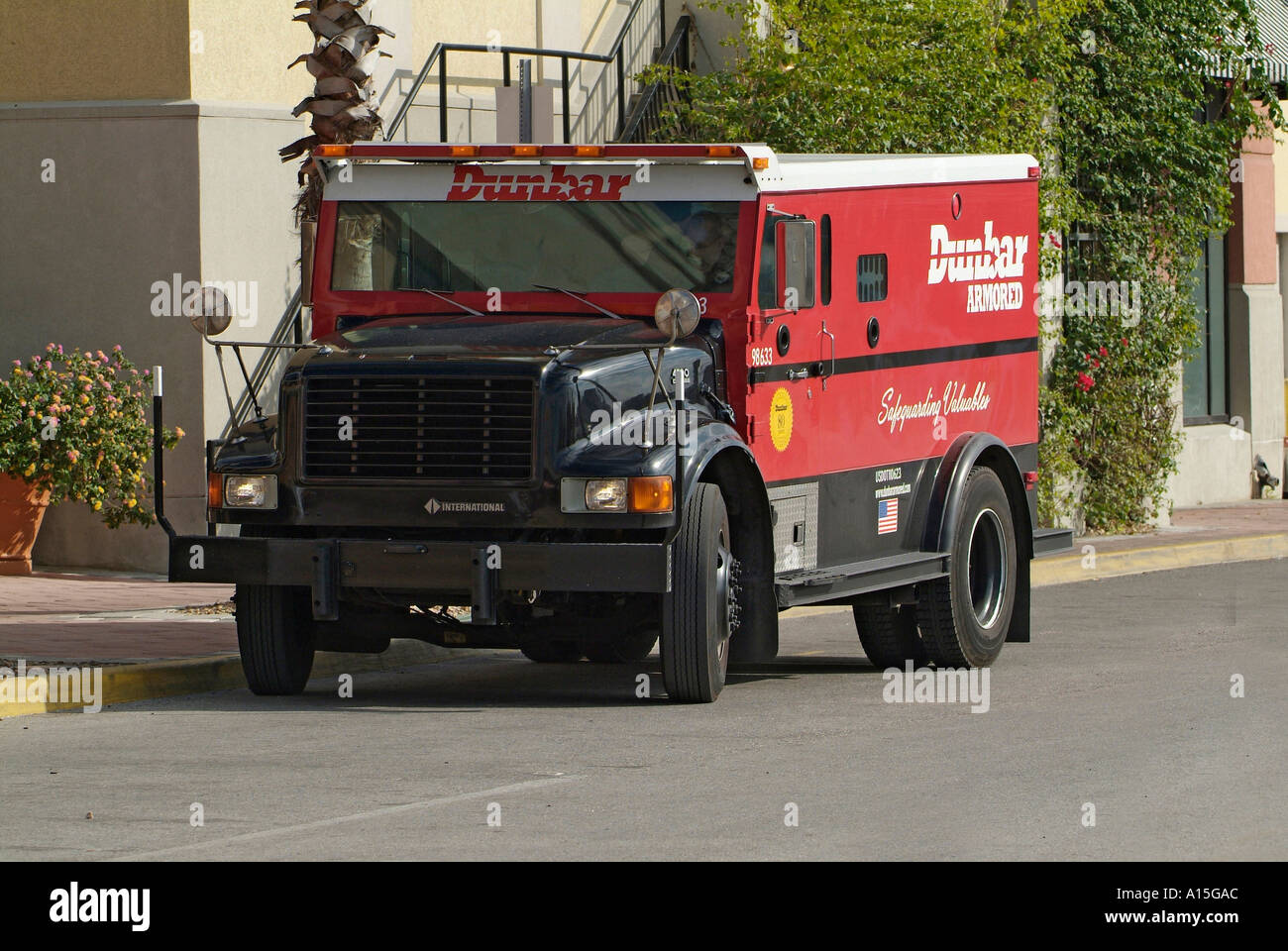 Armored Truck collects cash money from businesses for deposit into ...
