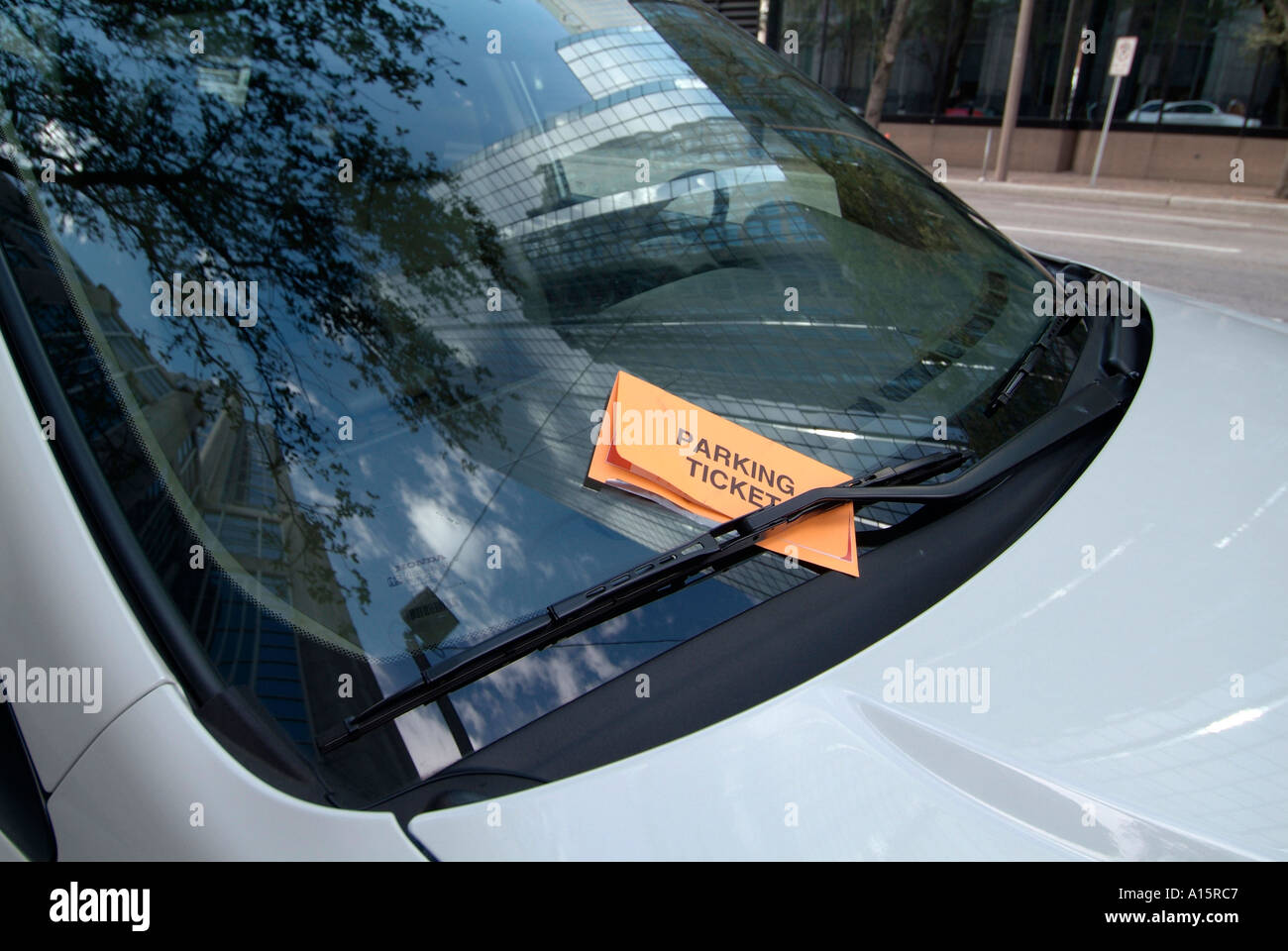 Parking ticket is issued to car parked at an expired parking meter in downtown Tampa Florida - Stock Image