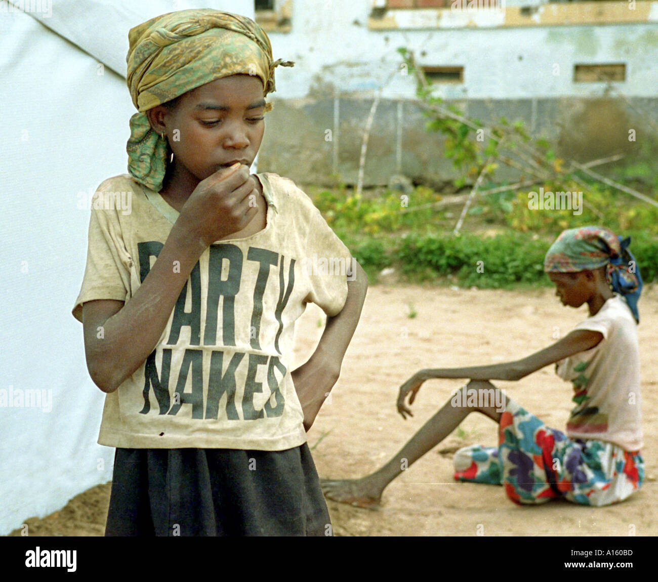 Angolans who are suffering from severe malnutrition wait to be treated in Kuito Angola. Angola's brutal 26 year-civil has - Stock Image