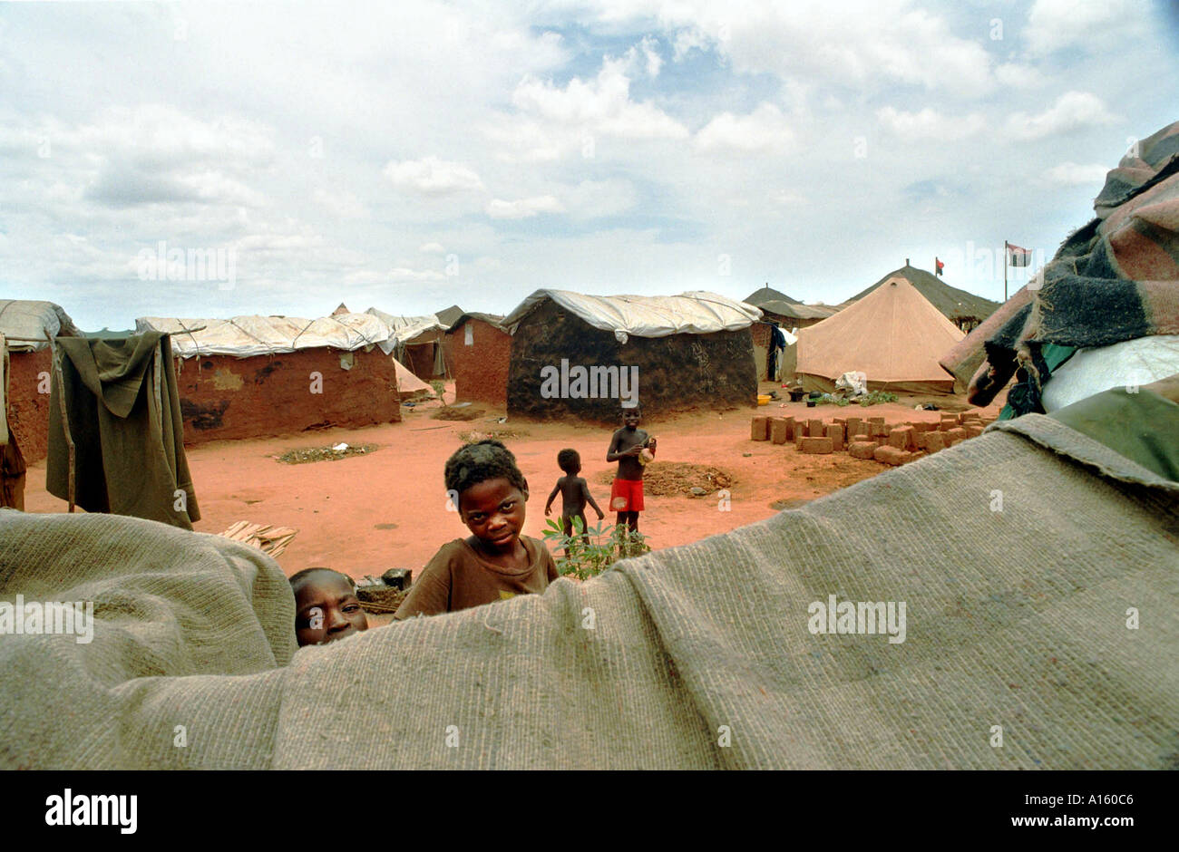 A refugee camp outside the capital of Luanda in Angola is shown in this file photo. President Jose Eduardo dos Santos who has - Stock Image