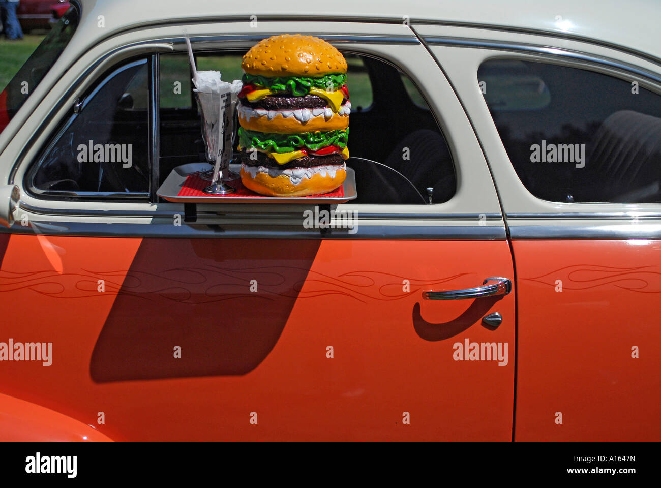 A  Plastic ^cheeseburger  and  drive-in ^window tray  on  ^1948 Chevrolet ^Fleetmaster  2 door . & A