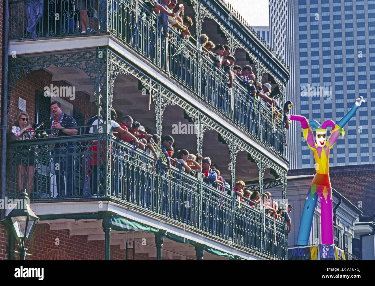 Onlookers At Balconies Of Royal Sonesta Hotel French Quarter Stock