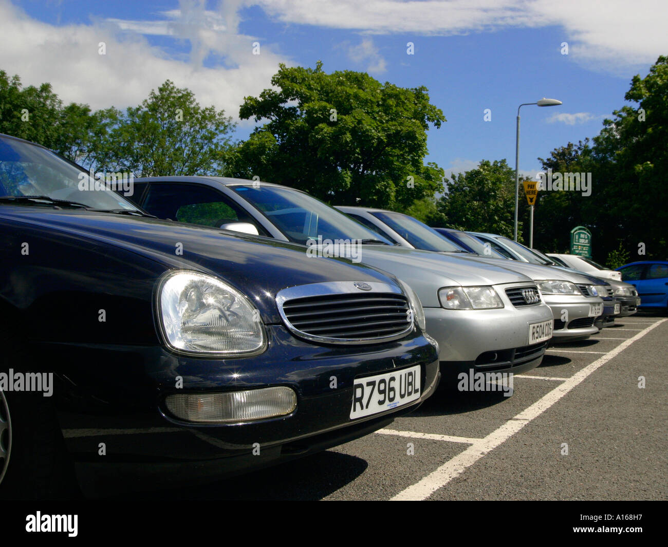 Cars parked in a public pay and display car park in England - Stock Image