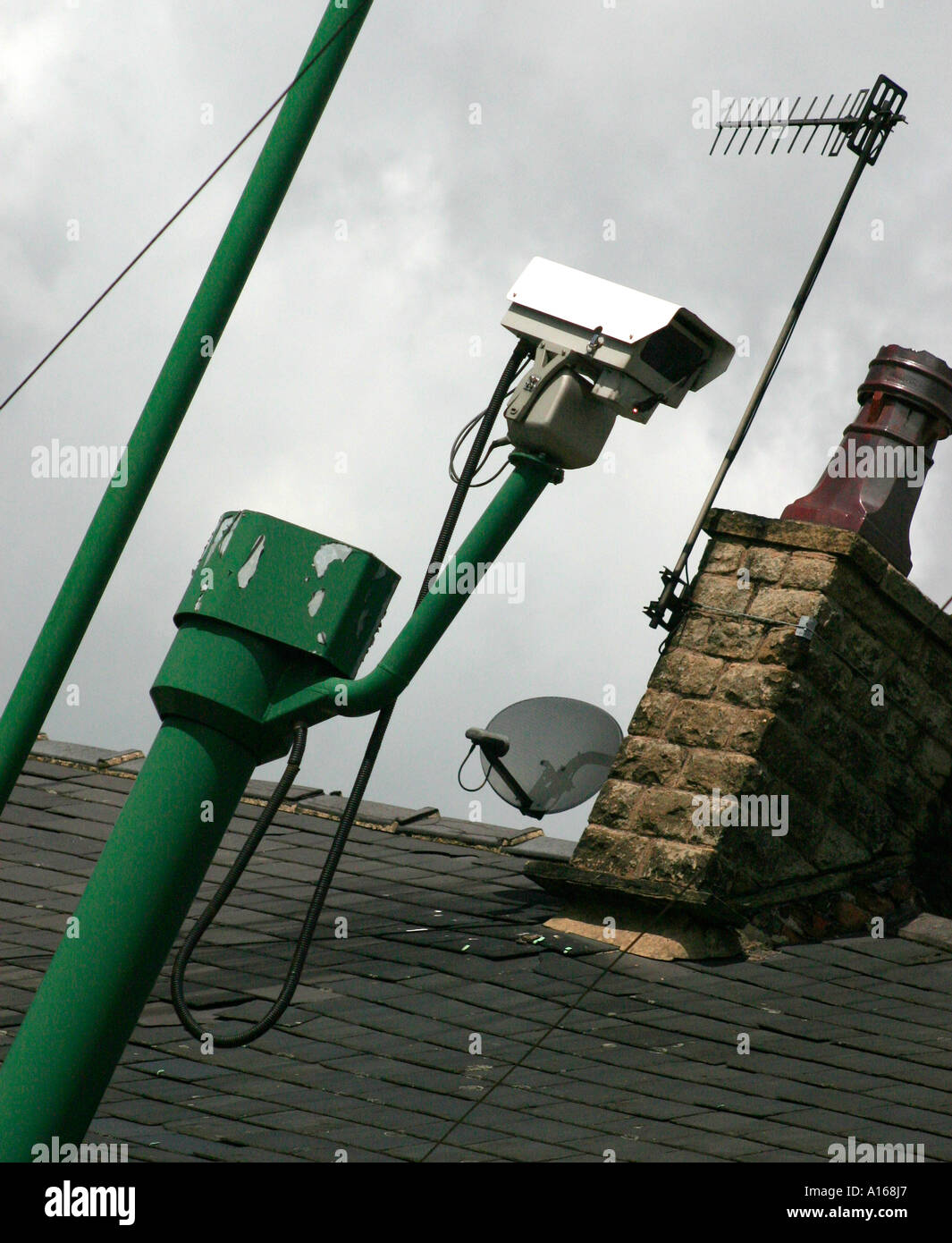 Closed circuit television camera or CCTV used for surveillance by the police in the UK - Stock Image