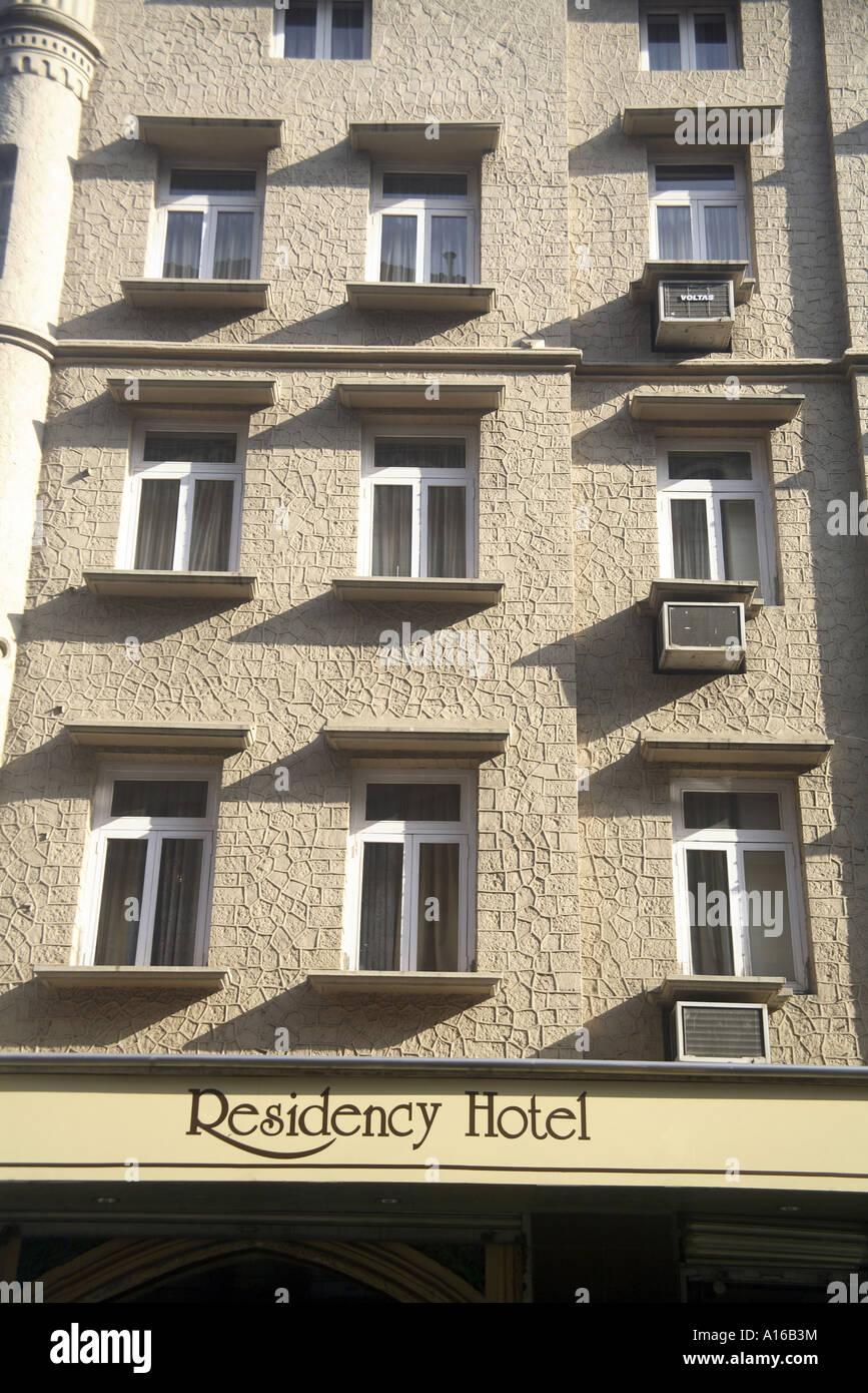 Nine windows of Residency Hotel old British gothic architecture on D N road near Handloom house Fort Bombay Mumbai - Stock Image