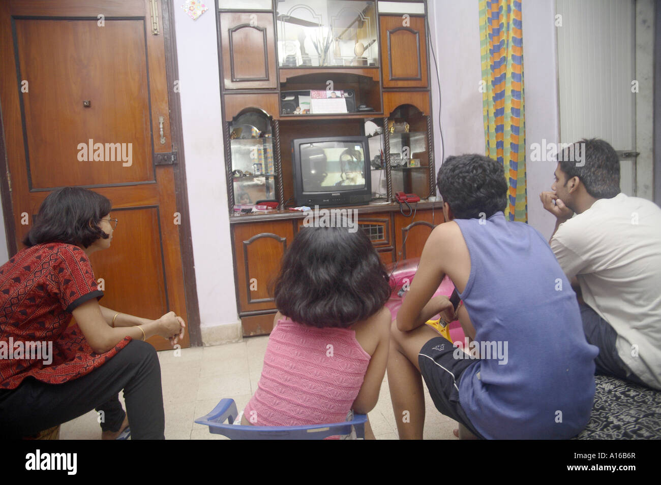 Indian middle class urban family of four father mother son ...