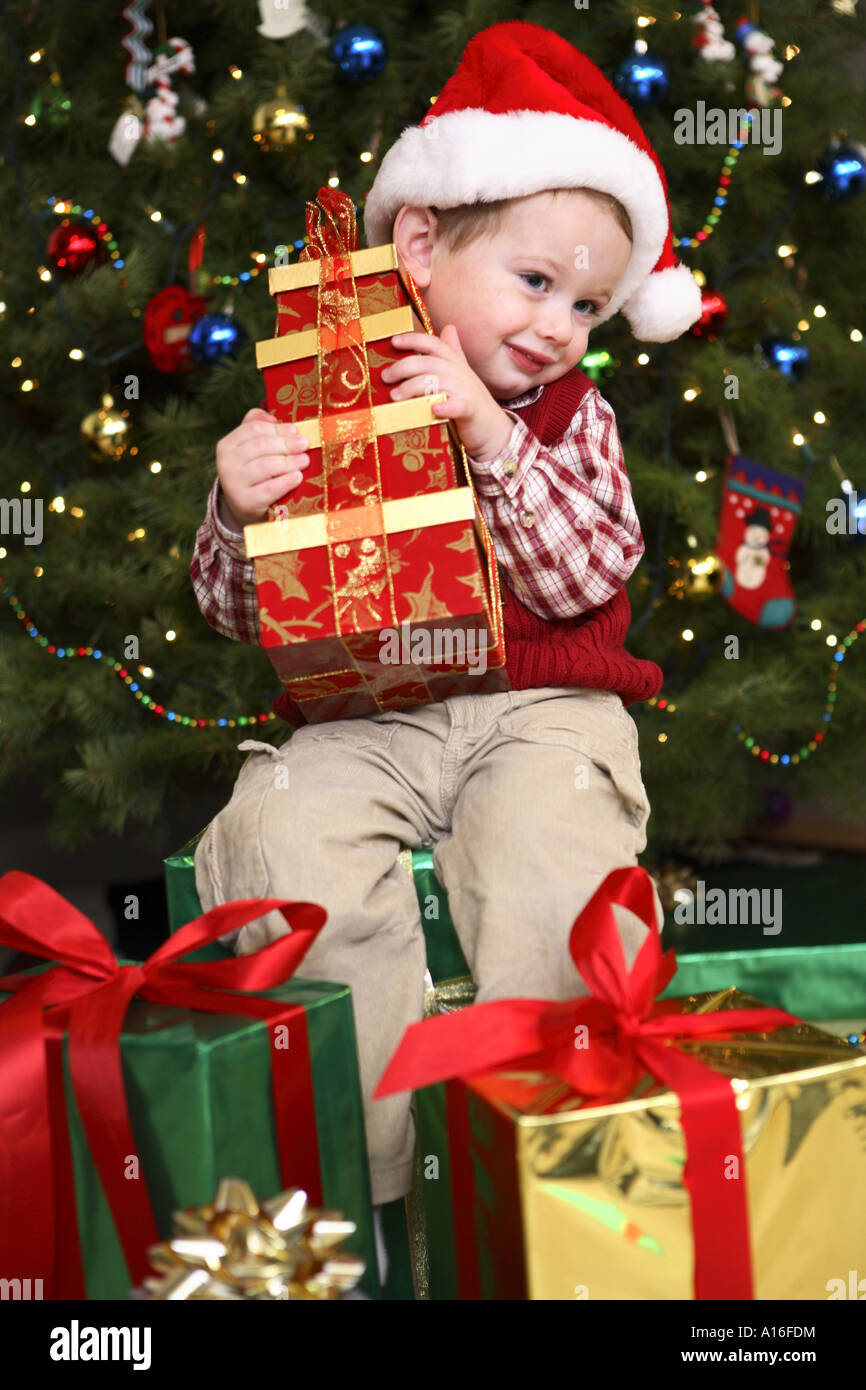 Two year old boy opening presents on Christmas morning Stock Photo ...